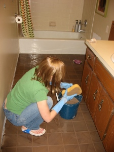 Removing the excess grout with a sponge