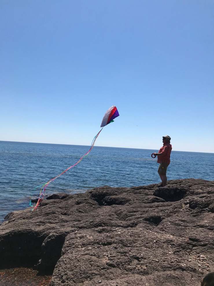 Flying a kite over the Lake Superior shore