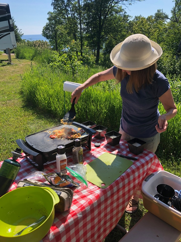 Cooking outdoors at the picnic table