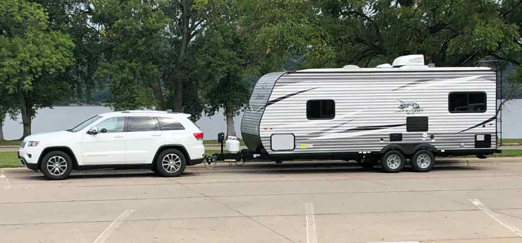 Jeep Grand Cherokee and Jayco Jay Flight 212QB at Lake City Minnesota rest area